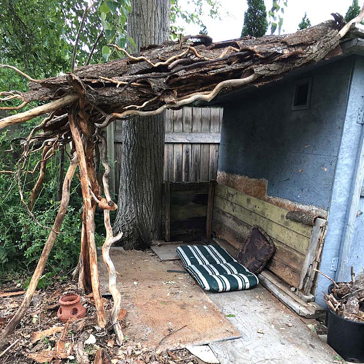 My new shack made of curly willow branches and bark created by me and my sister Sheila